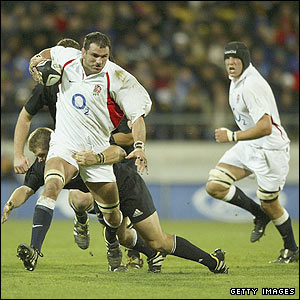 Martin Johnson charges forward during the clash against New Zealand in Wellington