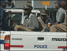 Soldiers in a police vehicle in Zimbabwe