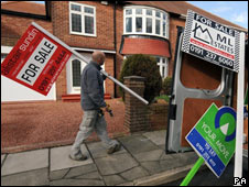 Man carrying For Sale sign