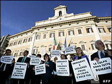 Northern League politicians hold placards outside parliament in Rome, November 2007