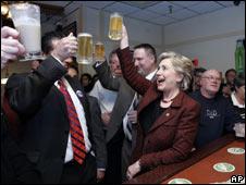 Senator Hillary Clinton raises a mug of beer  in a toast on 12 April