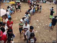 People queuing for cheap rice in Manila