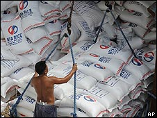 Man unloads rice imports in Manila