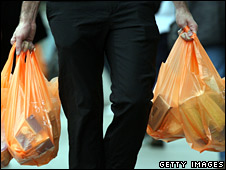 Shopper with Sainsbury's bags