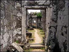 A path leads through a series of stone doorways at Preah Vihear