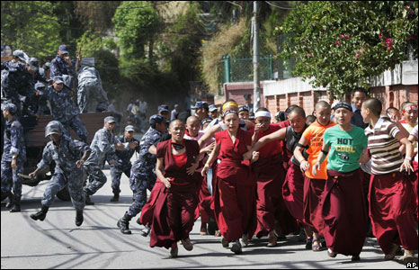 Tibetans are chased by police officers outside the Chinese Embassy in Katmandu, Nepal, 17 April 2008