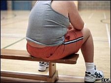Overweight child sitting on a bench