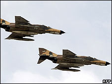Iranian F-4 jets fly past during the Tehran parade on 17 April