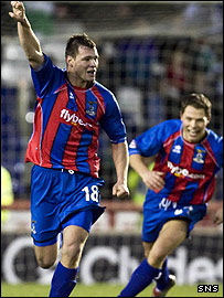 Marius Niculae (left) celebrates a goal for Inverness