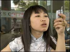 Chinese woman using mobile, BBC