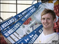 Liam Craig holds a cardboard version of the Scottish Cup