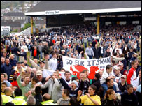 Supporters celebrated after staying in the Football League