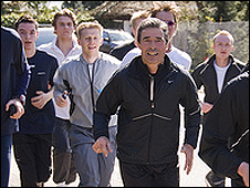 Danish PM Rasmussen (centre) with joggers, 18 Apr 08