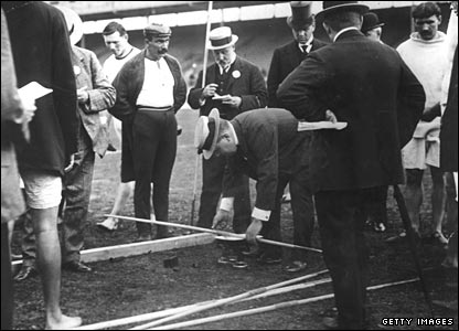 A javelin is weighed at the 1908 Olympic Games