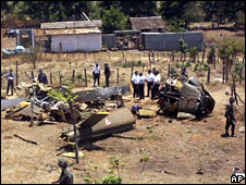 Police and army personnel cordon off the site where a military helicopter crashed near Uruapan, Mexico, on 18 Friday 2008