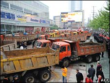 Protesters use lorries to block access to an outlet of the French Carrefour chain in Hefei, eastern China