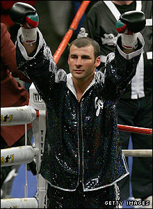 Calzaghe savours the cheers of his large army of fans as he enters the ring