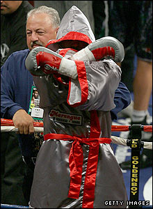 Bernard Hopkins follows the British man into the ring