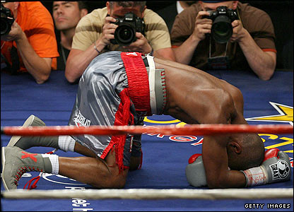 Hopkins slumps to the canvas after receiving a low blow