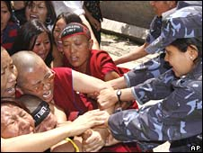 Tibetan nuns scuffle with Nepali police in Kathmandu on Thursday