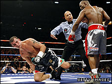 Joe Calzaghe is knocked to the floor by Bernard Hopkins