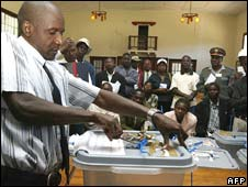 Election official opens a ballot box as part of the vote recount in Domboshava, east of Harare, on Saturday