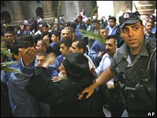 Israeli police attempt to break up scuffles that erupted at the Church of the Holy Sepulchre in Jerusalem on Sunday
