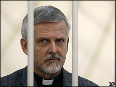 "US pastor Phillip Miles in a defendant""s cage during trial in Moscow"