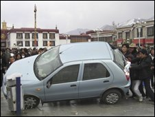 Rioters overturn a car in the Tibetan capital Lhasa, March 2008