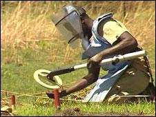 Man looking for landmines