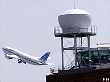 plane at air traffic control tower