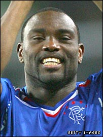Jean-Claude Darcheville claps the Rangers fans