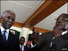 South Africa President Thabo Mbeki (L) and his Zimbabwean counterpart Robert Mugabe in Harare on 12 April
