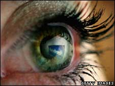 Eyeball reflecting Facebook logo