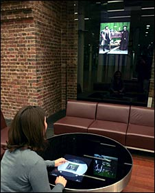 A woman using the interactive gallery