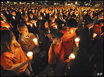 Students hold candles during a ceremony at Virginia Tech (Photo: AP/Don Petersen)