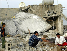 Residents of Basra weep after their house is destroyed by an explosion (7 April 2008)