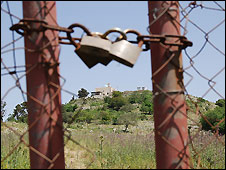 Iqrit in the distance behind locked gate