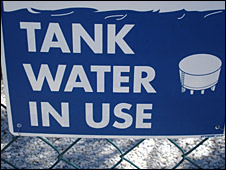 A sign showing tank water in use