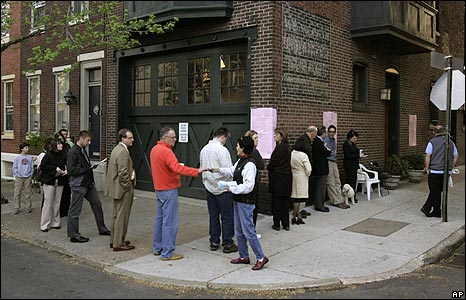 Voters queue in Philadelphia to vote in Pennsylvania's Democratic presidential primary