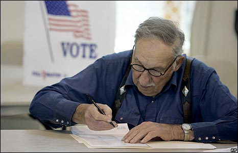 Omar Graybill fills in a ballot paper before voting in Pennsylvania's democratic Presidential primary