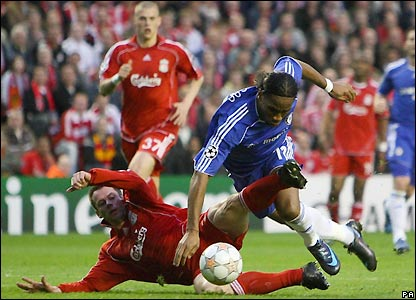 Drogba takes a tumble under Jamie Carragher's challenge