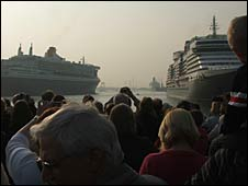 QM2 sails in to join the QE2 (background) and the Queen Victoria (foreground)