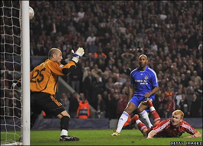 Riise watches as his header beats Pepe Reina