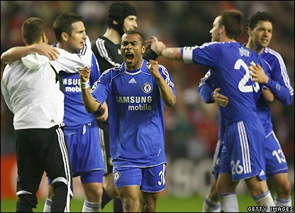 Ashley Cole celebrates with his team-mates