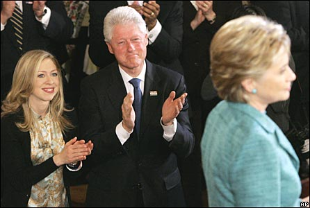 Chelsea Clinton and her father, ex-President Bill Clinton, applaud Hillary Clinton's primary win in Philadelphia on 22 April 2008