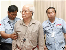 Khieu Samphan is helped to the dock for a hearing Wednesday, April 23, 2008