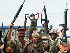 Iraqi troops celebrate after gaining control of a district of Basra - 19/4/2008