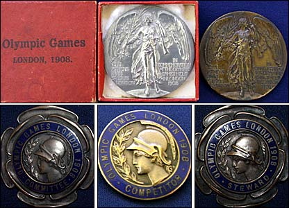 Commemorative medals (top) and lapel badges for officials, competitors and stewards (bottom)