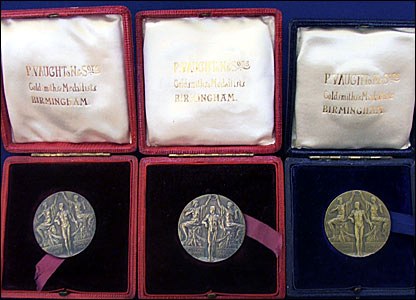 Gold and silver medals from the yacht races - the medal depicts two women placing a laurel wreath on the head of the winner